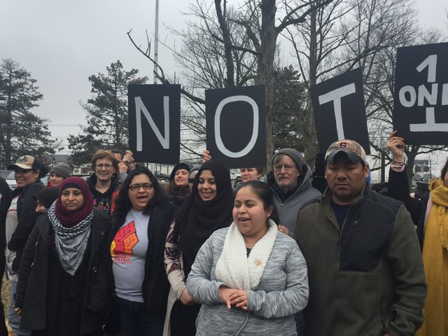 Arely Tomas and Hector Navarro with supporters at ICE office in Batavia, NY.JPG