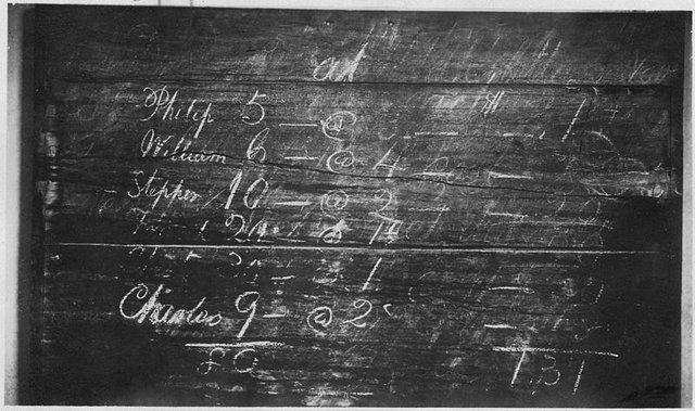 800px-._Possibly_an_arithmatic_problem_on_blackboard_in_schoolroom.__BAH_1917__-_NARA_-_297408.jpg