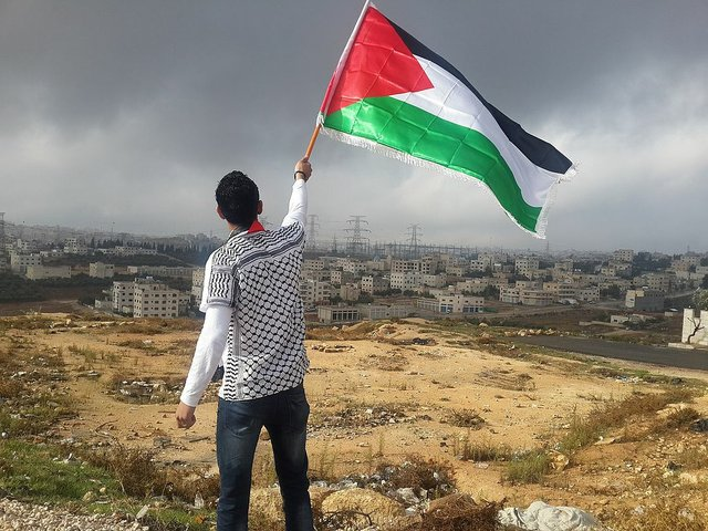 Flag-Of-Palestine-Arab-Man-Waving-1081797.jpg