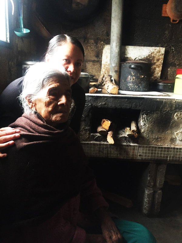Fatima with her 102-year-old grandmother by the wood-burning stove. .jpg