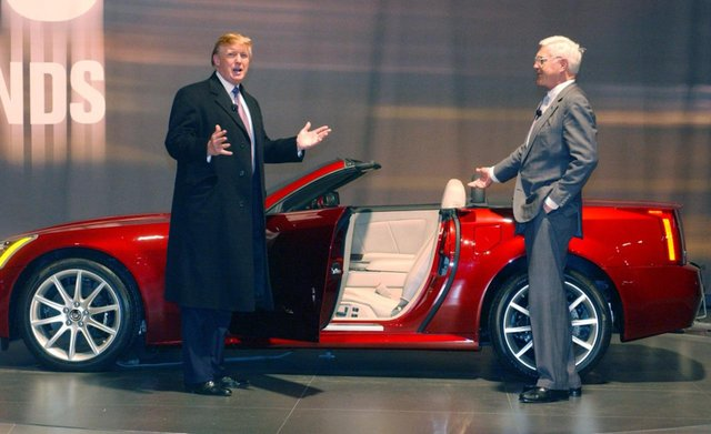 1024px-Donald_Trump_previews_the_2006_Cadillac_XLR-V_(8619546909).png