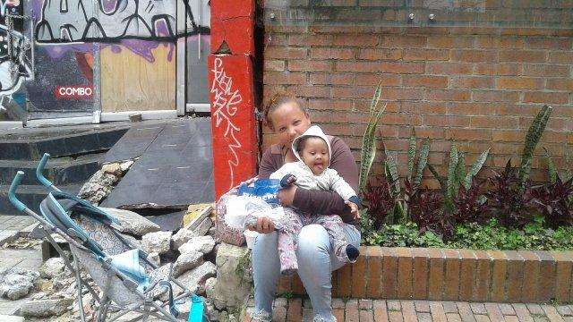 bogota-venezuela-poverty-street-child-woman-migration-venezuelan-alms-need-homeless-informal-work-recreation-road-play-girl-fun-vacation-1460005.jpg