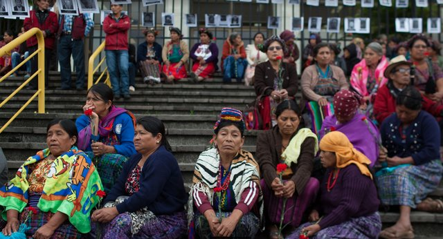 Ixil Mayan genocide survivors gather outside the Guatemalan Supreme Court demanding justice for their loved ones.