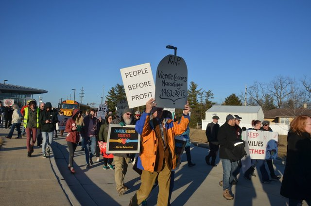 Protesters march against Dwight detention center.jpg