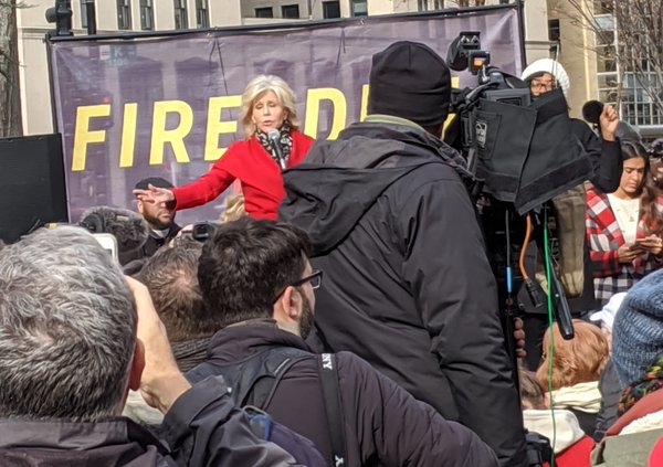 Jane Fonda addresses crowd about the connection between  climate change and immigration a few blocks from the White House, photo by Jason Miller.jpg