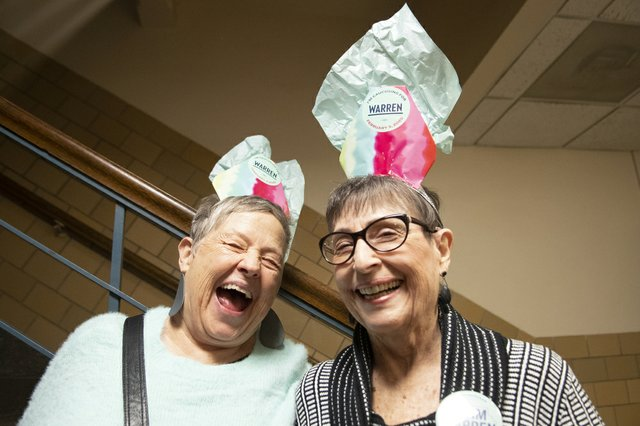 Warren supporters Lou Cathcart (left) and Phyllis Boone in the hallway at the caucus site in Ames, Iowa.
