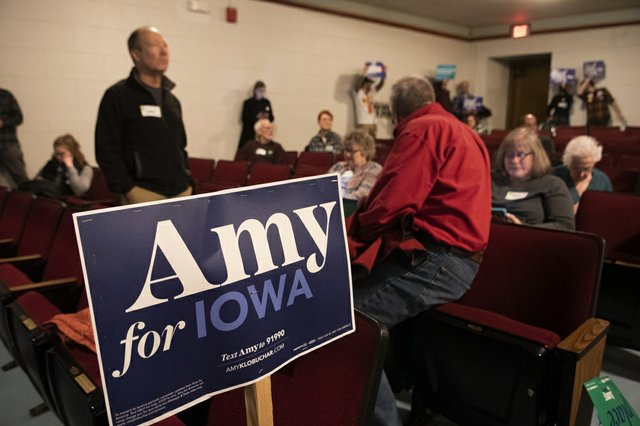 Amy Klobuchar supporters gather in Ames, Iowa, caucus floor. They did not have enough supporters to be viable after the first round of voting. They had forty-eight, but needed eighty-five to remain viable.