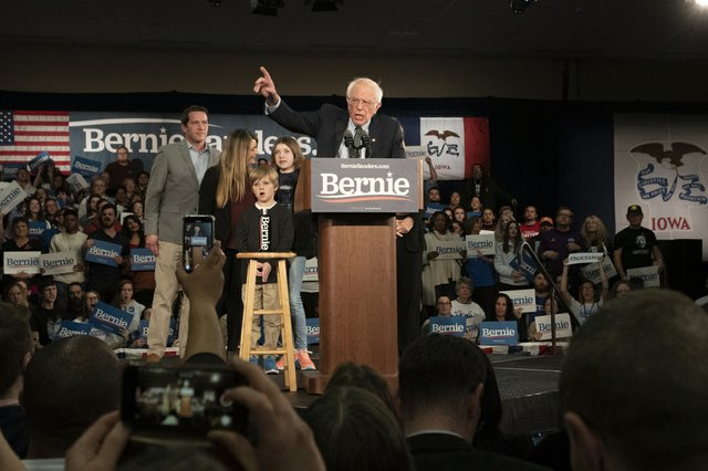 Sanders addresses the crowd at the Holiday Inn Des Moines Airport Hotel and Conference Center.
