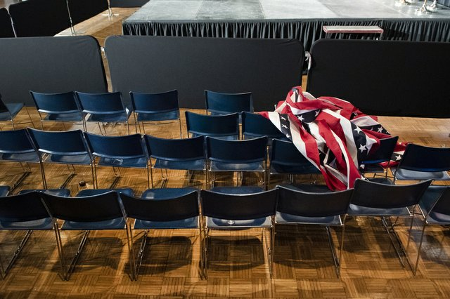 The party is over. A flag banner lies crumbled up on chairs at the end of the Joe Biden event at the Olmsted Center at Drake University.