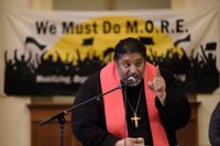 Rev. Dr. William J. Barber II speaks at We Must Do M.O.R.E. tour stop in Des Moines on January 15, 2020, photo by Steve Pavey.jpeg