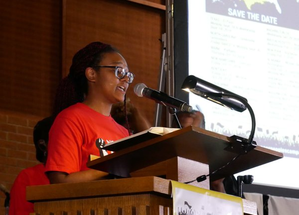 Jamila Allen testifies at We Must Do M.O.R.E. tour stop in Greenfield, Massachusetts on February 5, 2020, photo by NC Raise Up.jpg