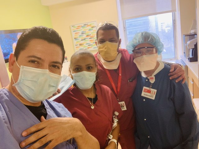Erasmo Ramos (left), with clean-up crew, at New York-Presbyterian Morgan Stanley Children's Hospital, April 2020, photo provided..jpg