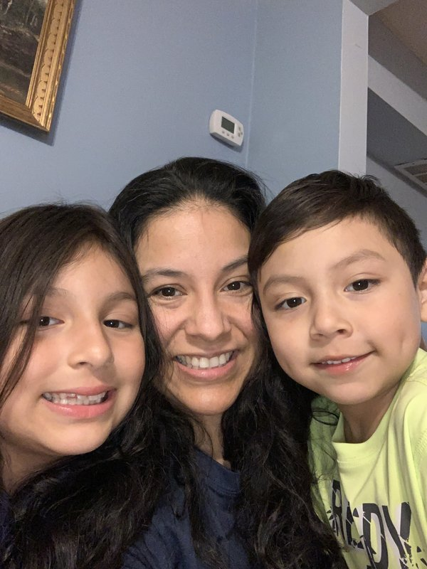 Claudia Marchan and children at their home, April 2020 , photo provided..jpg