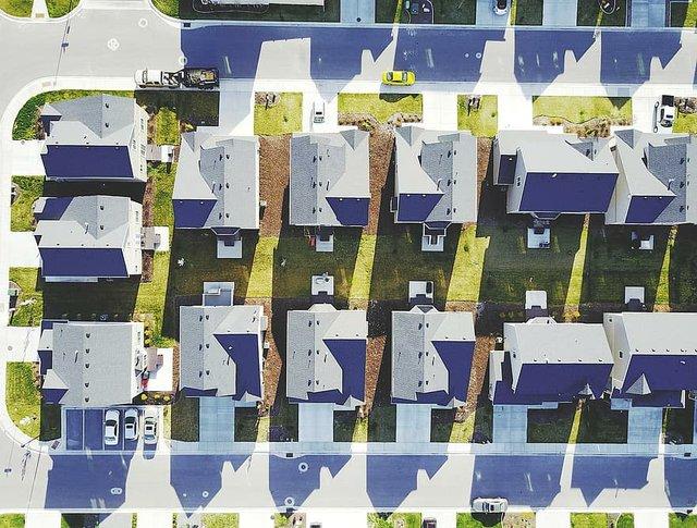suburbs-homes-neighbors-neighborhood-suburbia-pattern-driveway-rooftops-aeriel.jpg