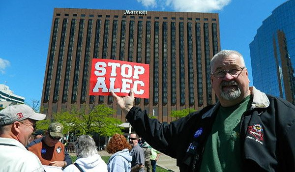 Stop_ALEC-protester_KC_Marriot600x350px.jpg.jpe