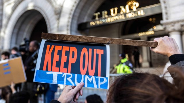 Keep_Out_Trump,_Protesters_outside_Trump_Hotel_on_Pennsylvania_Ave,_DC_(30816244091).jpg