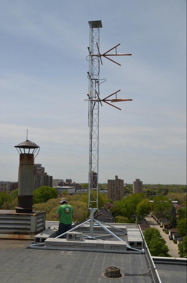 Tower_and_engineer_overlooking_neighborhood.JPG